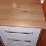 Kitchen cabinets and benchtops are clean and contemporary