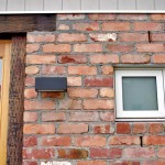 Reclaimed timber door frames and lintel, and recycled exterior brickwork.