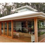 Wrap-around deck and floor to ceiling glass