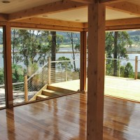 Open plan living area opening onto wrap-around deck