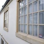 Windows also framed in local sandstone