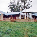 Mud brick rural home with conservatory.