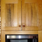 The kitchen cabinets were made from discarded fence palings.
