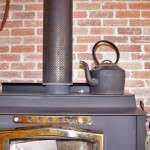 A wood stove augments winter heating.
